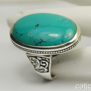 Sterling Silver Turquoise Ring - 16.2 grams.